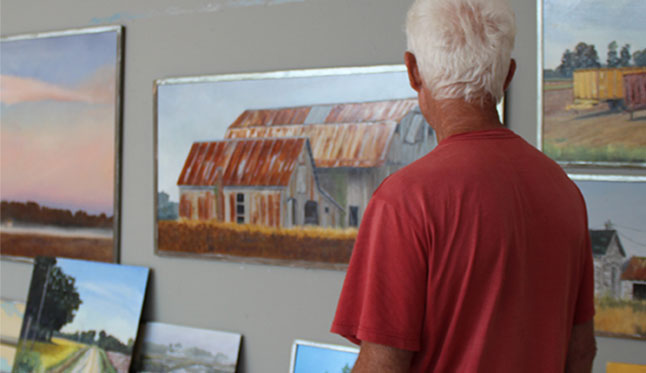 A Visitor Studies Carroll Lassiter's Landscapes