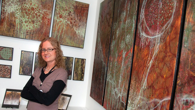 Shelly Hehenberger in front of her work at the tour